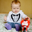 Baby boy playing toy — Stock Photo