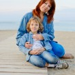 Mother and daughter resting near the sea — Stock Photo #40207703