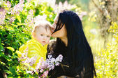 Mother kissing baby daughter — Stock Photo