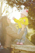 Mother and baby daughter in spring time — Stock Photo