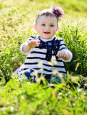 Baby in green grass — Stock Photo