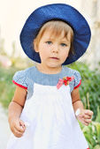 Toddler with little flowers — Stock Photo
