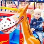 Boy in the amusement park — Stock Photo