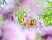 Girl in spring flowers garden — Stock Photo