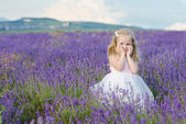 Sweet girl in lavender field — Stock Photo
