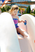 Toddler on the water slide — Stock Photo
