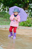 Toddler girl at rainy day i — Photo