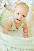 Happy baby in crib — Stock Photo