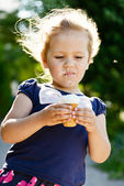 Little girl eating ice-cream — Stock Photo