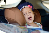 Child crying in car — Stock Photo
