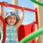 Happy girl on the playground — Stock Photo