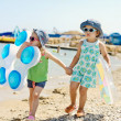 Two friends on the summer beach — Stock Photo