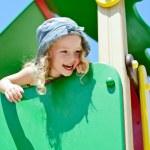 Child having fun on the playground — Stock Photo