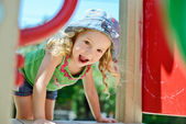 Happy face of toddler on the playground — Stock Photo