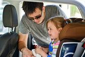 Father fastening daughter — Stok fotoğraf
