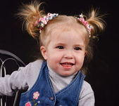 Little girl with ponytails — Stockfoto
