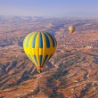 Stock Photo: Hot air balloon flying over CappadociTurkey