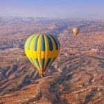 Hot air balloon flying over Cappadocia Turkey — Stock Photo #13244241