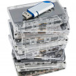 Stack of audio cassettes and flash memory — Stock Photo