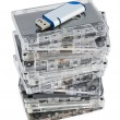 Stack of audio cassettes and flash memory — Stock Photo #13301407