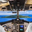 Royalty-Free Stock Photo: Pilots in the plane cockpit and island