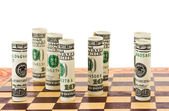 Money on chess board — Stock Photo
