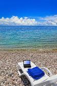 Notebook on beach — Stock Photo