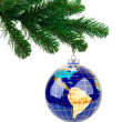 Globe and christmas tree — Stock Photo