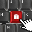 Stock Photo: Computer keyboard with gift key