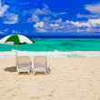 Chairs and umbrella at tropical beach — Stock Photo #13895869