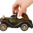 Hand and toy retro car — 图库照片