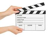 Cinema clapboard in hands — Stock Photo
