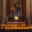 Icon and candles in cathedral at Salzburg Austria — Stock Photo