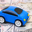Toy car on money background — Stock fotografie