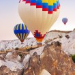 hot air balloon flying over cappadocia turkey — Stock Photo #14434289