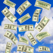 Stock Photo: Falling money and sky