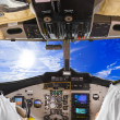 Stock Photo: Pilots in the plane cockpit and sky