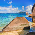 Stones on tropical beach — Stock Photo #14560069