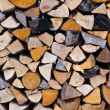 Firewood logs wood background - Stock Photo