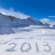 2013 on snow at mountains — Stock Photo
