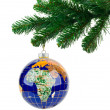 Globe and christmas tree - Stock Photo
