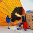 Stock Photo: Hot air balloon and pilots at CappadociTurkey
