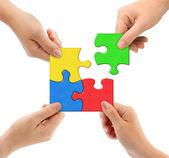Hände und puzzle-team — Stockfoto