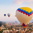 Hot air balloon flying over Cappadocia Turkey — Stock Photo #19522551