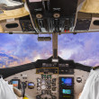 Stock Photo: Pilots in the plane cockpit and sunset