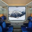 Interior of train and mountains in window — Stok fotoğraf