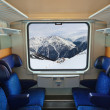 Interior of train and mountains in window — ストック写真