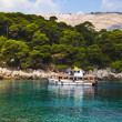 Boat and island in Croatia — Stock Photo