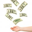Hands and falling money — Stock Photo