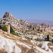 Uchisar cave city in Cappadocia Turkey - Stock Photo